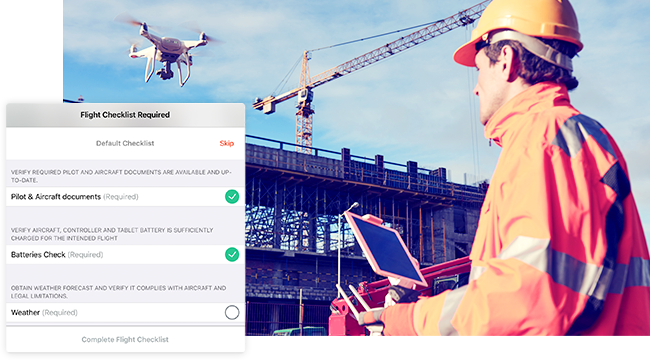 Drone professional in an orange hard hat flying a drone over a construction site